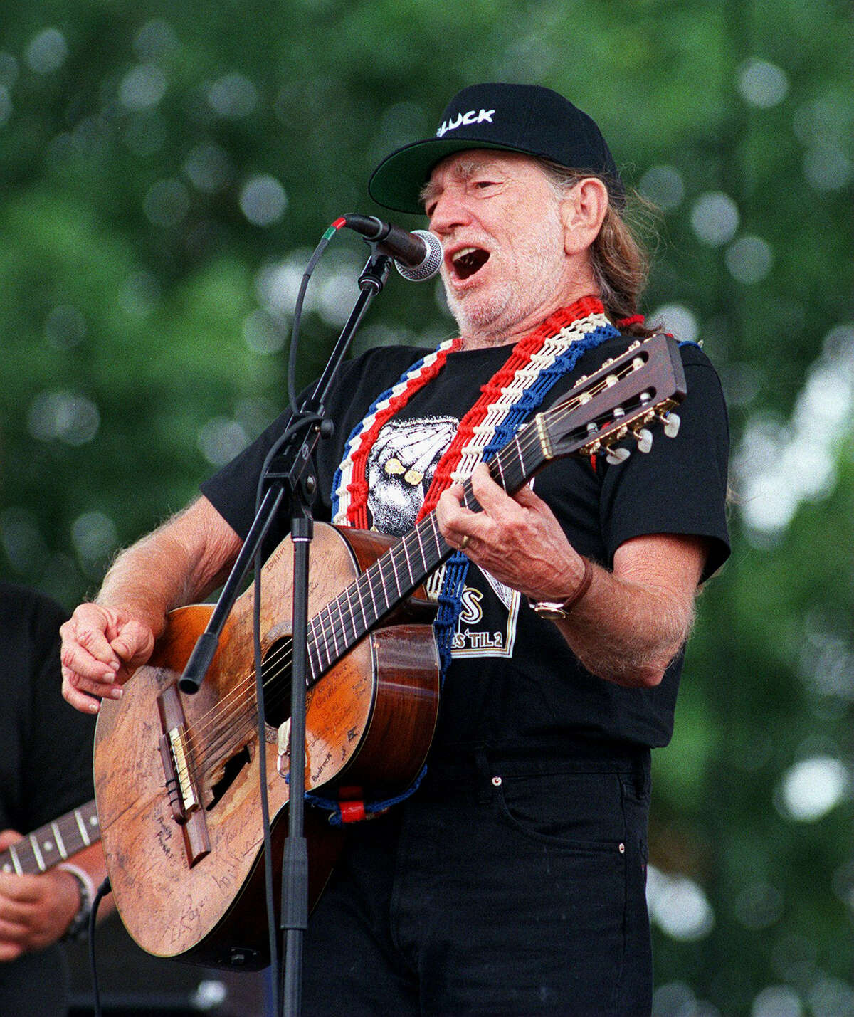 Willie Nelson belts out a tune at his Fourth of July picnic in Luckenbach, Texas in 1998.
