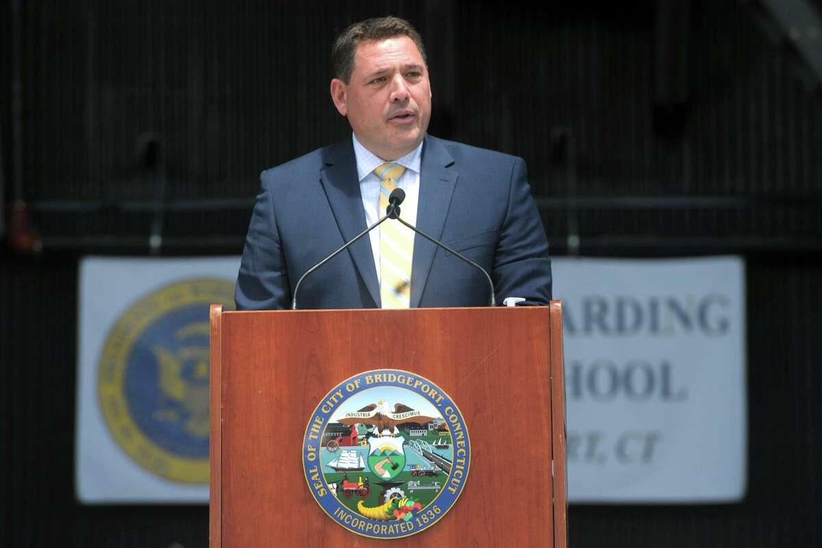 Superintendent of Schools Michael Testani speaks during graduation for the Warren Harding High School Class of 2021, at the Hartford Healthcare Amphitheater in Bridgeport, Conn. June 16, 2021.
