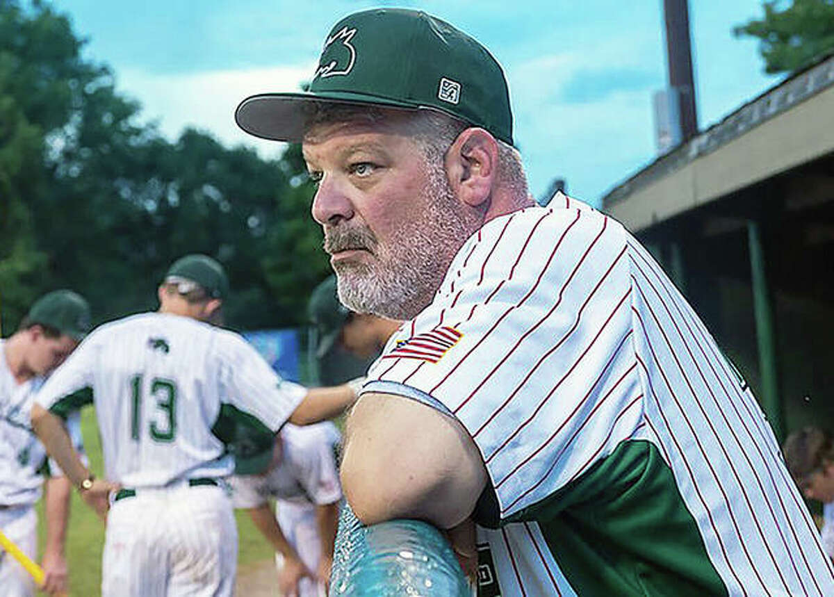 Alton River Dragons manager Darrell Handelsman watches a recent game from the dugout at Lloyd Hopkins Field in Gordon Moore Park.