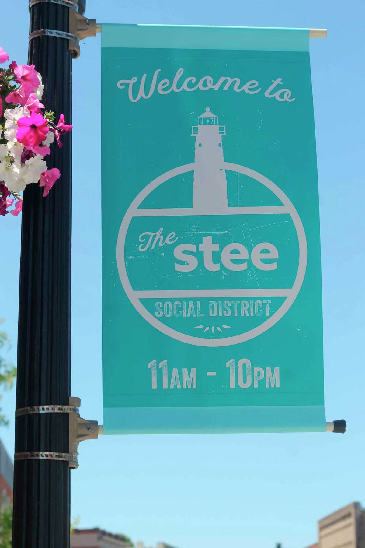 Saturday at 11 a.m. marks the opening of Manistee's social district, adesignated area downtown where patrons age 21 and up can purchase an alcoholic beverage from a participating establishment and carry and consume it outdoors. (Kyle Kotecki/News Advocate)
