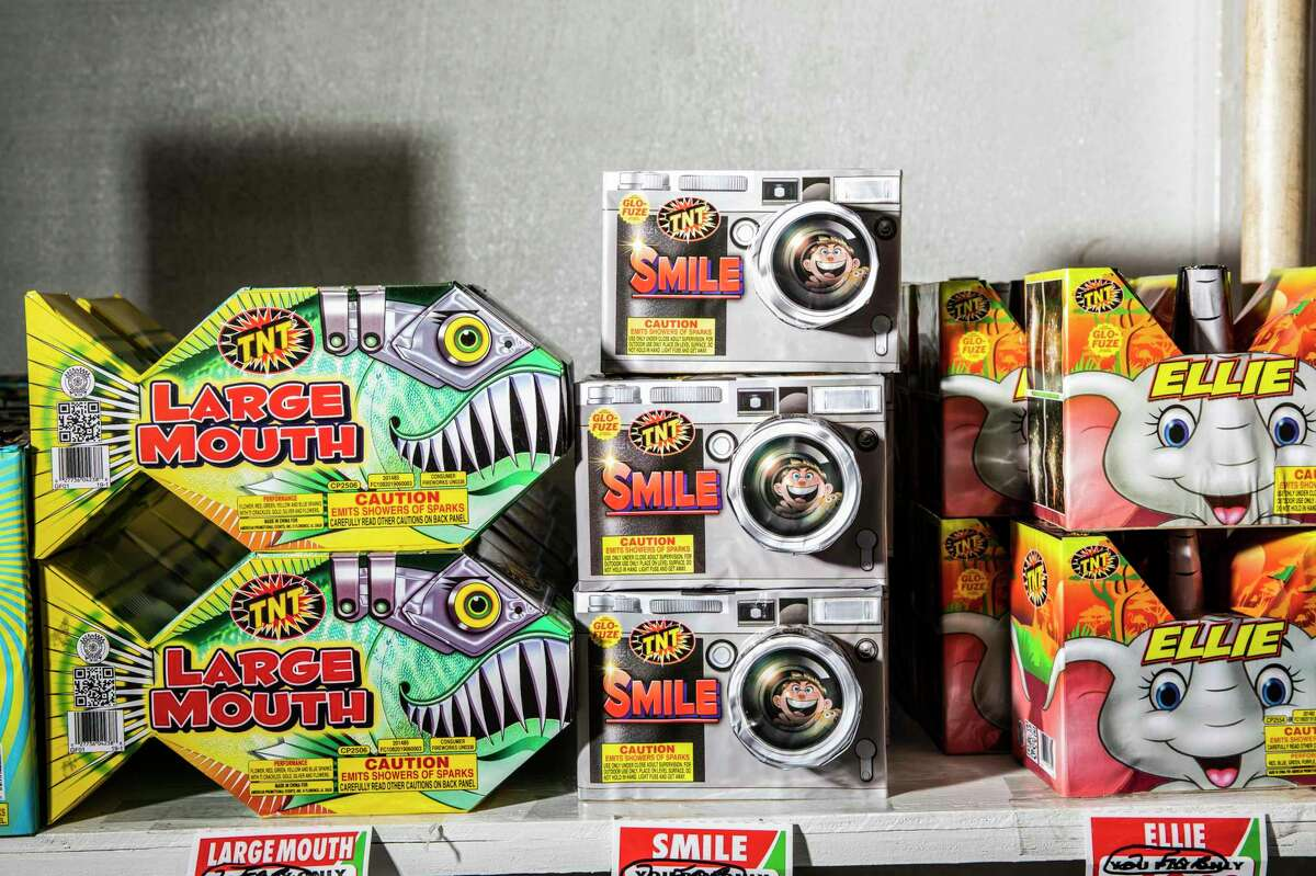 Boxes of fireworks are seen inside a TNT Fireworks booth in the parking lot of San Bruno Towne Center in San Bruno, Calif. As San Francisco and other Bay Area cities ready Fourth of July celebrations, more than 100 scientists urged the public to forgo potentially wildfire-sparking fireworks.