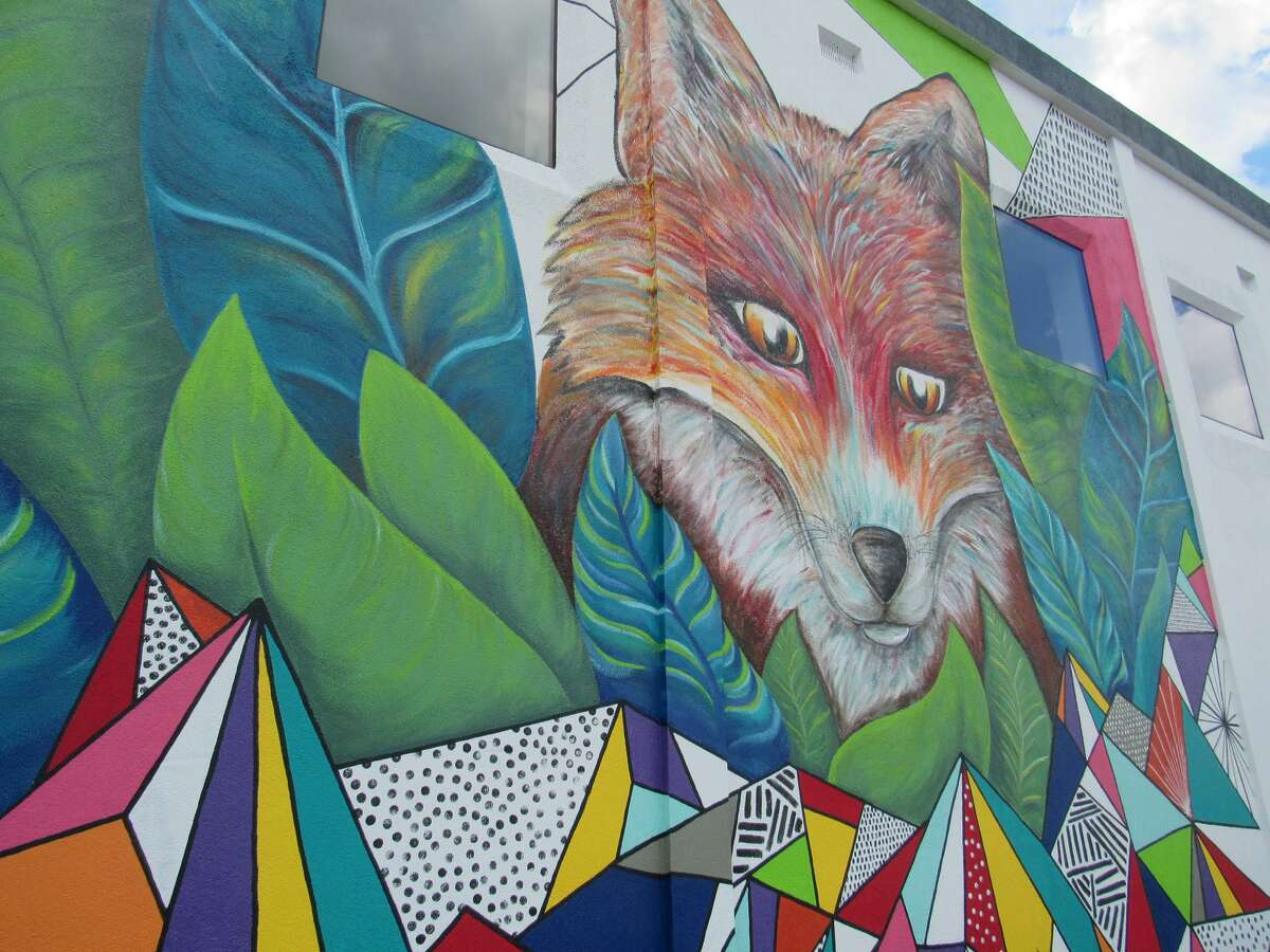 Community members helped paint a mural designed by Dacia Parker and Jazzmyn Benitez in Downtown Midland as part of the inaugural Art Seen Festival.