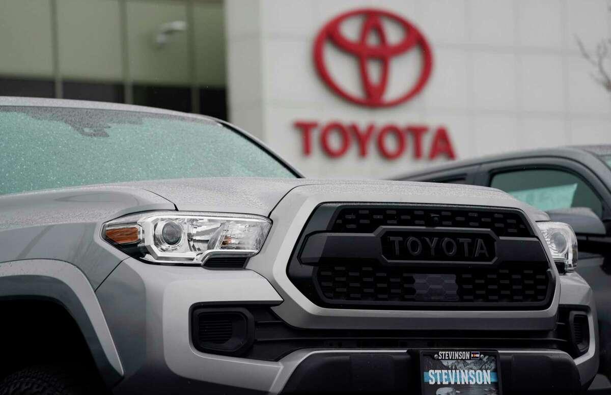 An unsold 2021 Tacoma pickup truck sits at a Toyota dealership Sunday, March 21, 2021, in Lakewood, Colo. (AP Photo/David Zalubowski)