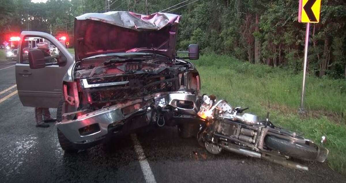 A truck and motorcycle are seen after a collision Wednesday on FM1484 in Conroe.