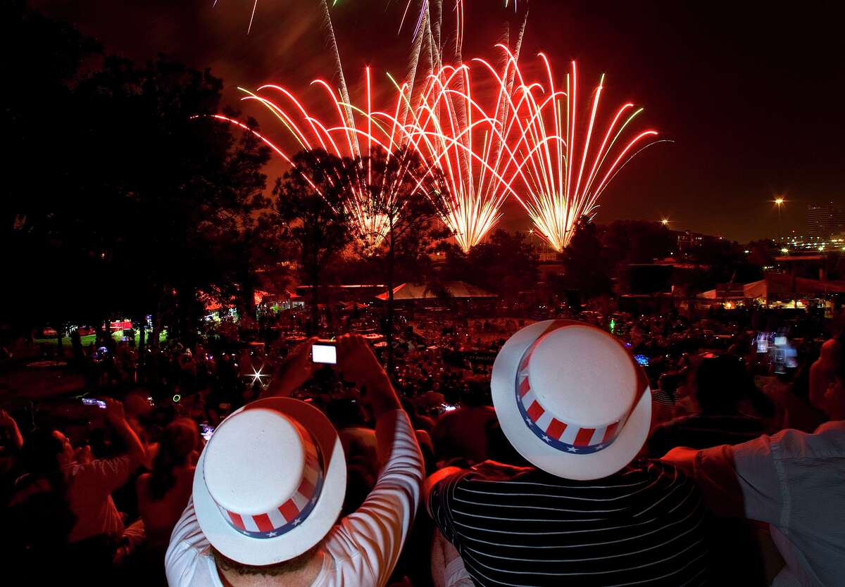 This year's Fourth of July celebrations may be more cautious than in years past, but they will involve the same opportunity to celebrate each other, as the posterity that the Founders envisioned would inherit the nation they created in 1776. Here, a couple watches the 2012 Houston's Fourth of July celebration at Eleanor Tinsley Park.