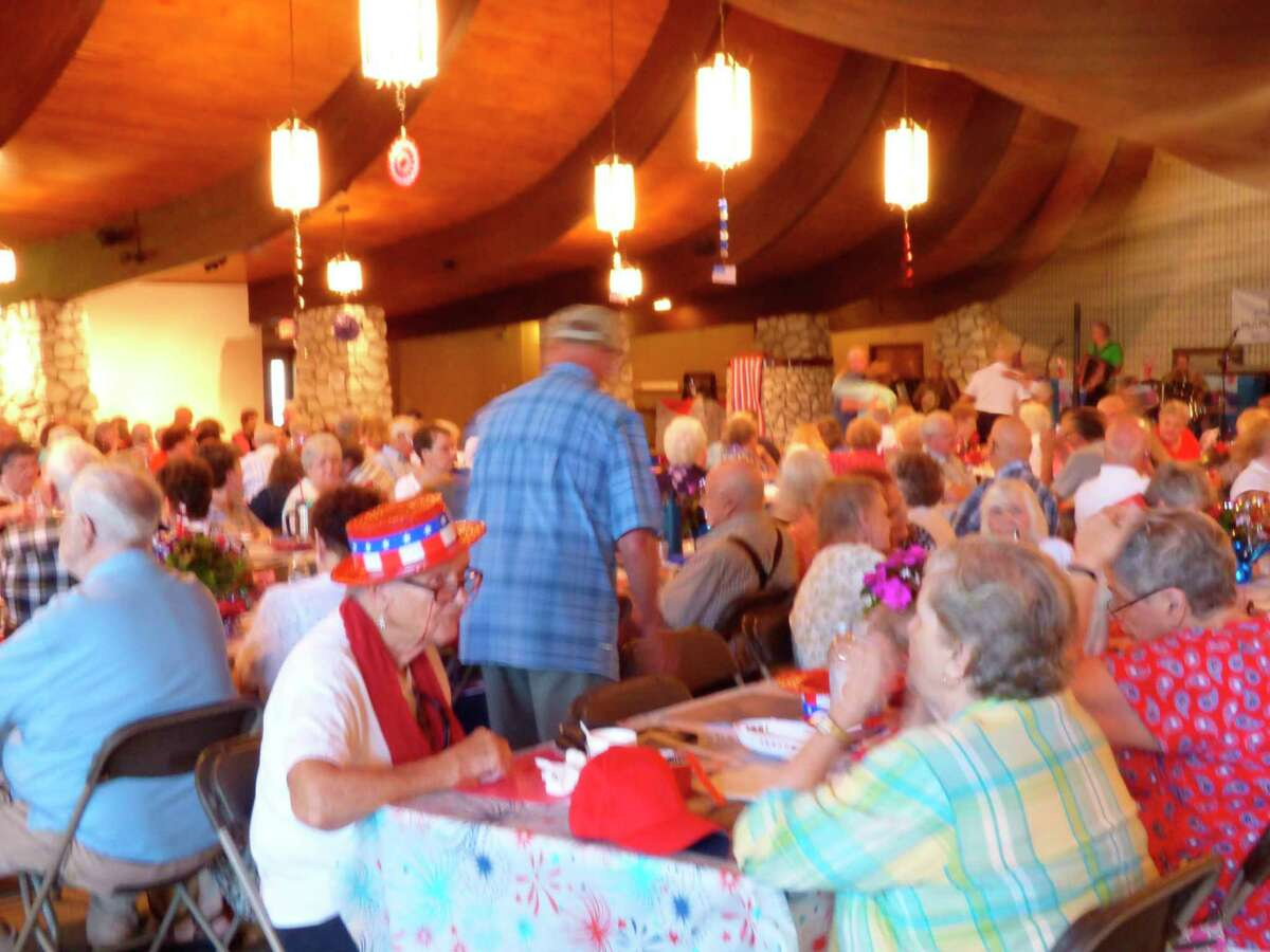 Attendance at a Fourth of July weekend kick-off event held at the Wagoner Community Center was high Thursday. Proceeds from the dinner and concert will go to benefit ongoing restoration work at the center. (Scott Fraley/News Advocate)