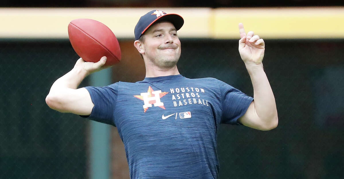 Houston Astros pitcher Joe Smith tosses a football around during batting practice before the start of an MLB baseball game at Minute Maid Park, Thursday, May 13, 2021, in Houston.