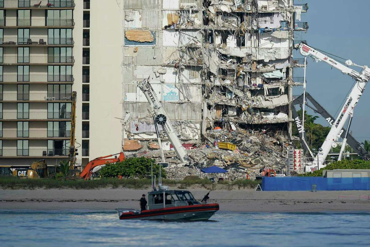 A U.S. Coast Guard boat patrols in front of the partially collapsed Champlain Towers South condo building in Surfside, Fla., which collapsed on June 24. Florida law has a 12-year limit on lawsuits, but some lawyers say the deadline may be less rigid in practice than it is on paper. The building was 40 years old.