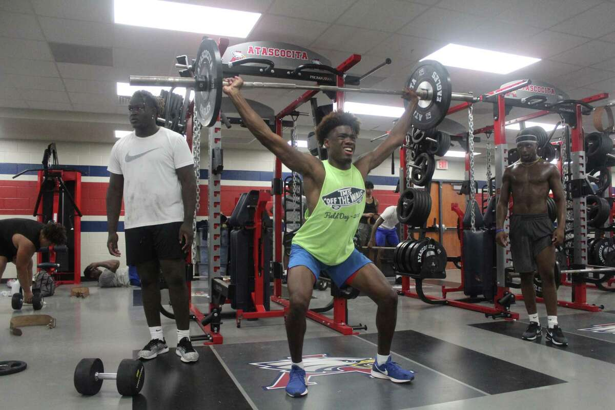 Atascocita wide receiver Keith Wheeler during a workout at summer workouts in the brand new weight Eagles weight room.