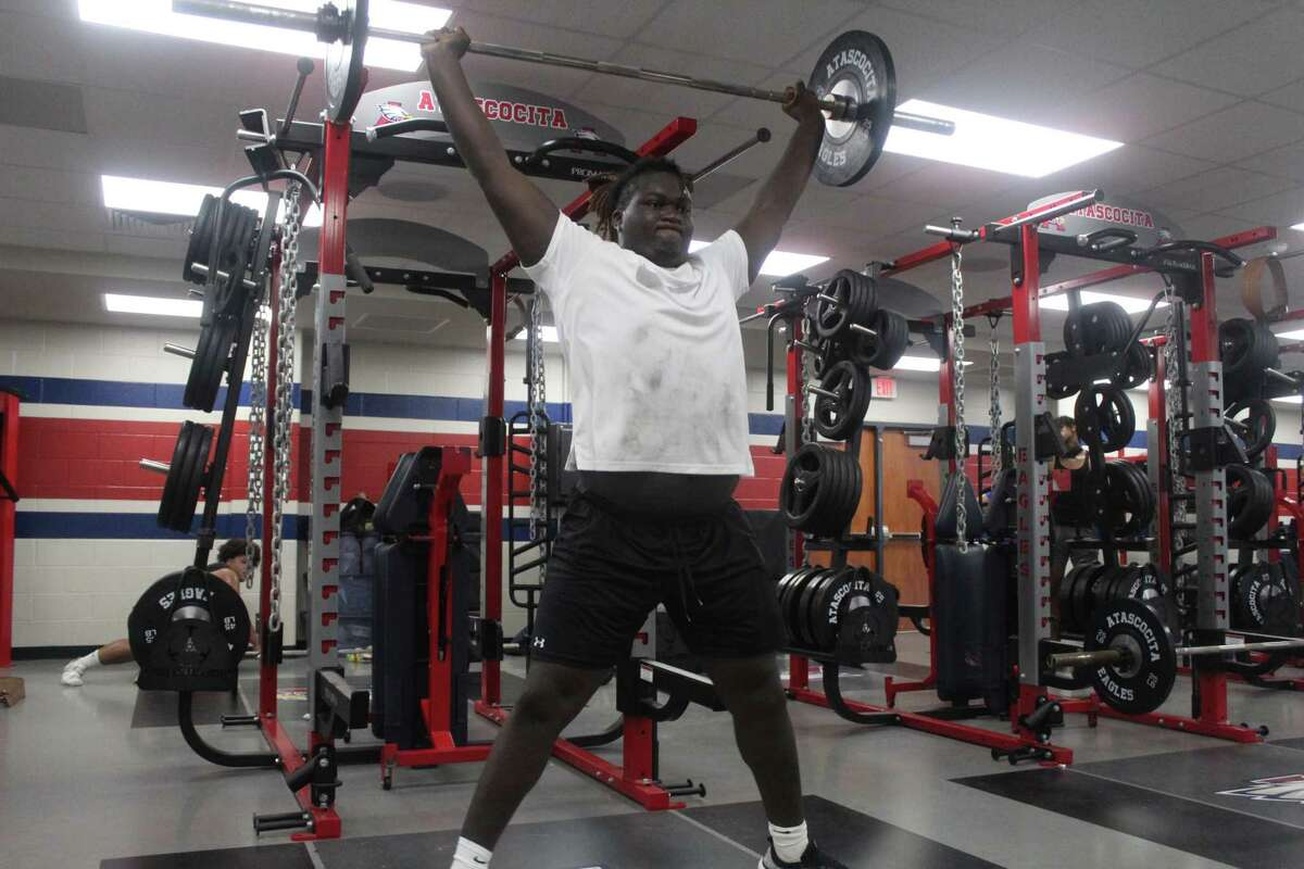 Atascocita offensive lineman Kam Dewberry during summer workouts in the Eagles' new weight room.