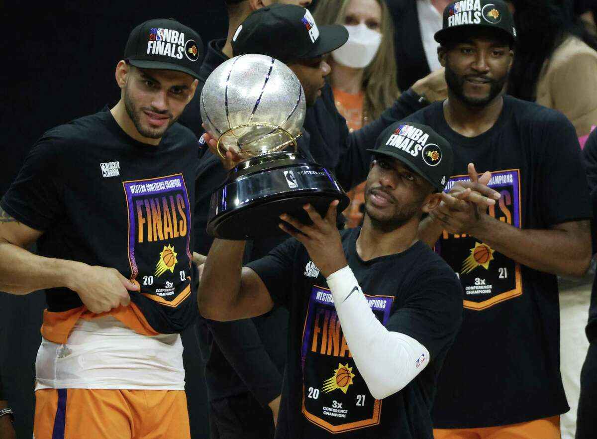 Chris Paul got to lift the Western Conference trophy for the first time in his career.