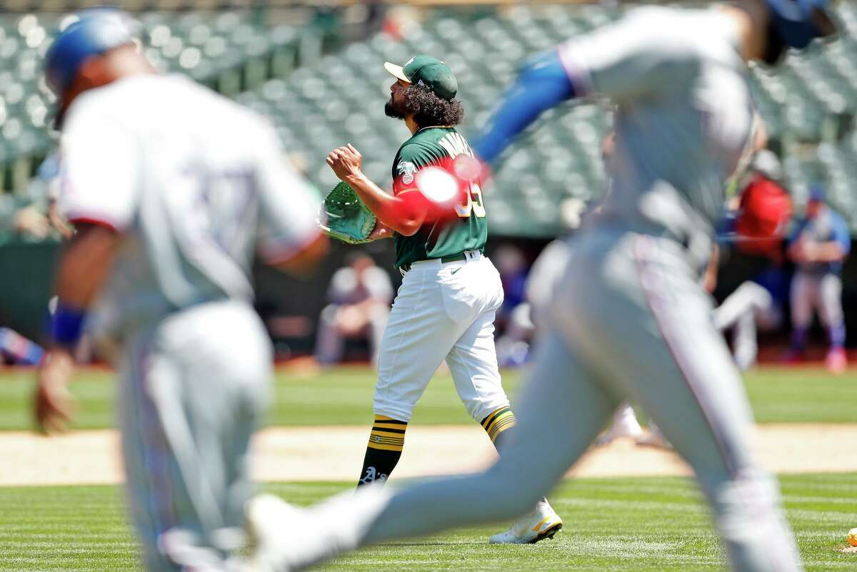 Oakland Athletics' Sean Manaea looks away as Texas Rangers' Joey Gallo rounds third base after his 2-run home run in 5th inning during MLB game at Oakland Coliseum in Oakland,, Calif., on Thursday, July 1, 2021.