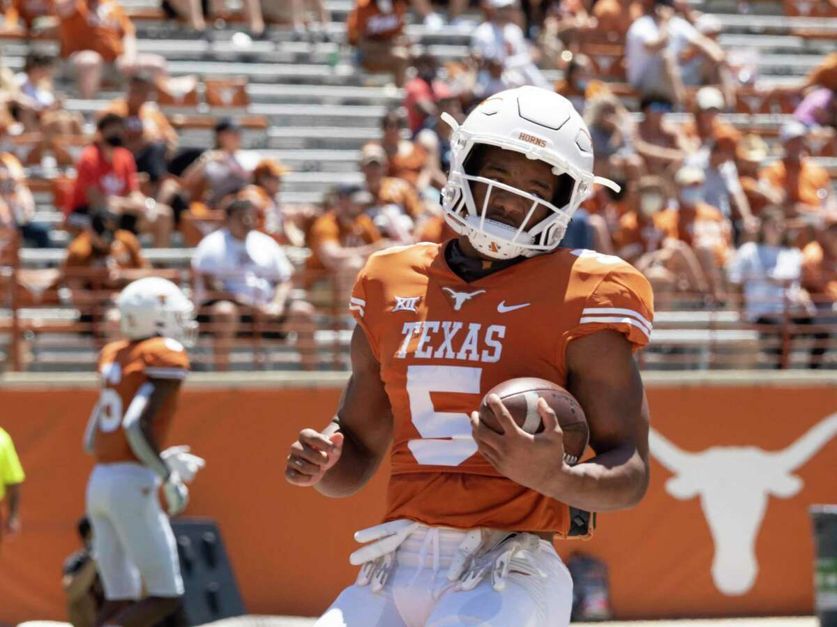 Texas running back Bijan Robinson warms up before the Texas Orange and White Spring Scrimmage on April 24 in Austin. By mid-morning Thursday, the first day the NCAA permitted athletes to profit off their name, image and likeness, Robinson was selling custom-made Cameo videos for $100.