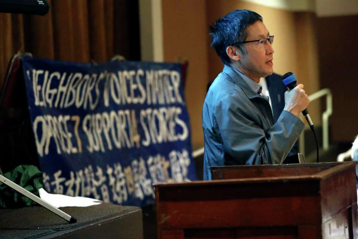 District 4 Supervisor Gordon Mar addresses the audience during a Sunset District community meeting at St. Anne's Church to discuss a plan to build a seven-story affordable housing development at 2550 Irving St.