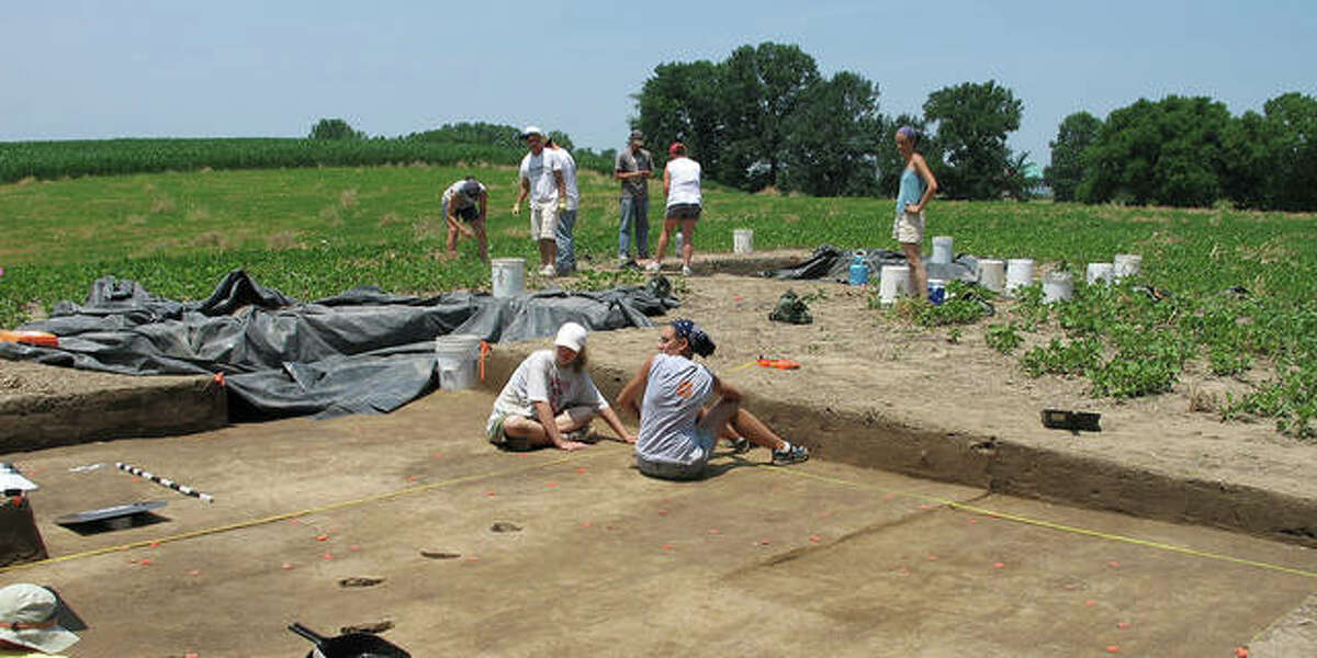 Students work at an archaeology dig with anthropology professor Julie Zimmermann.