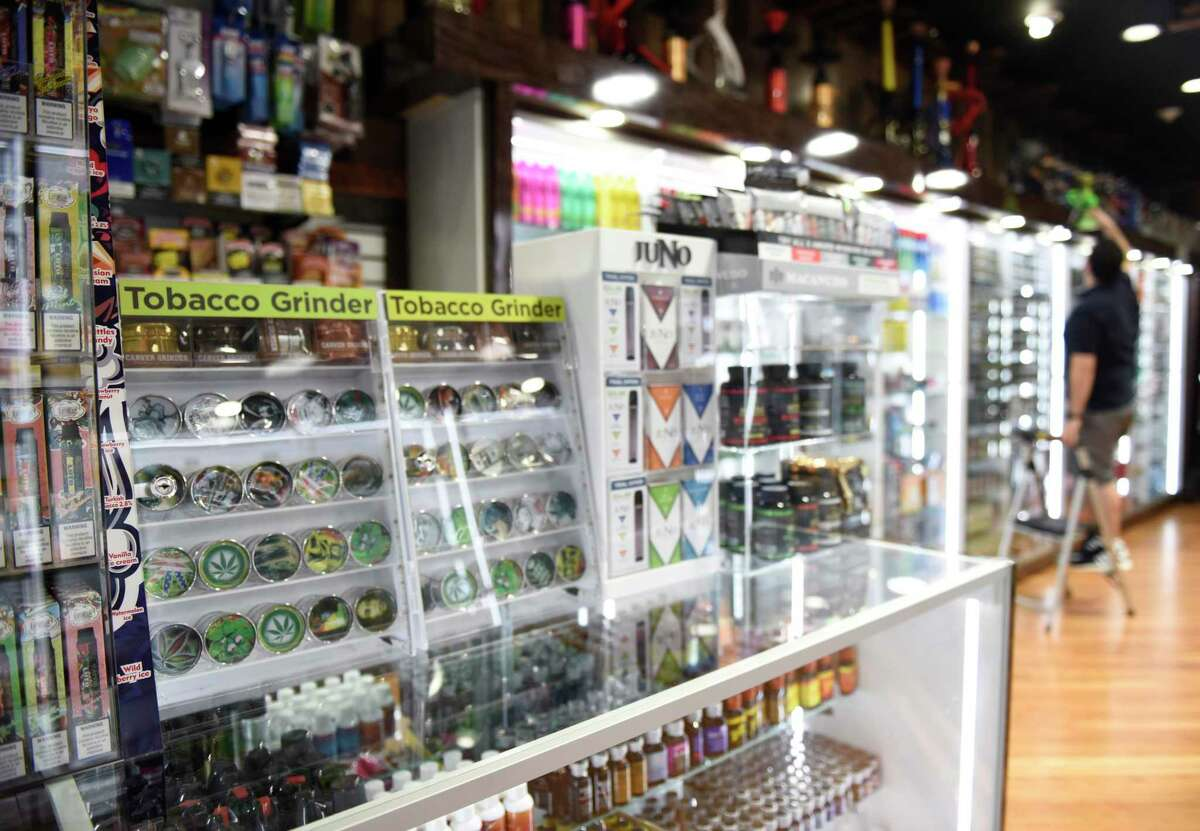Grinders and accessories are sold at the new tobacco shop Smoke Times at 108 Bedford St. in Stamford on Thursday.