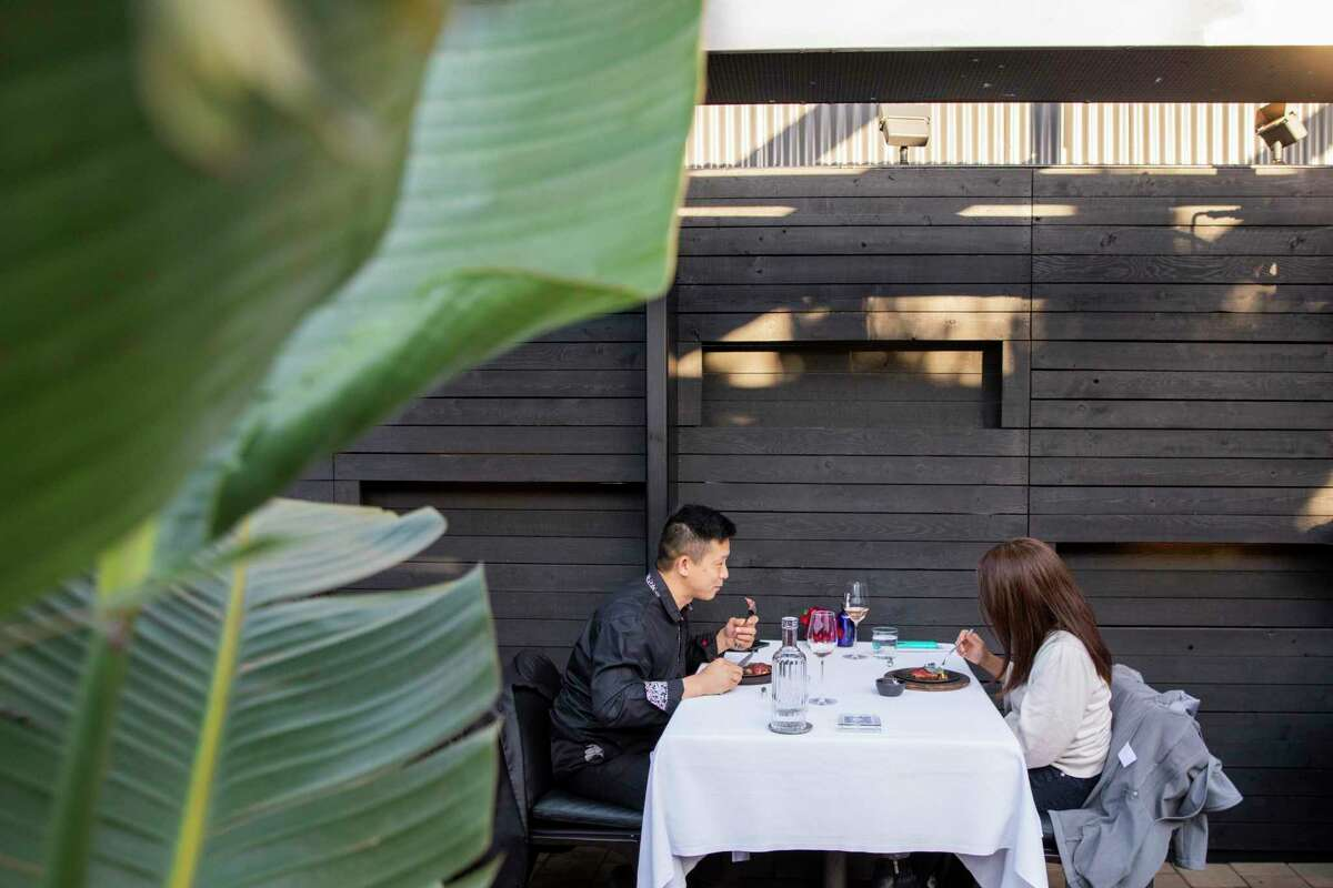 Daniel Chan (left) and Katherine Chan have their anniversary dinner at Californios in S.F.