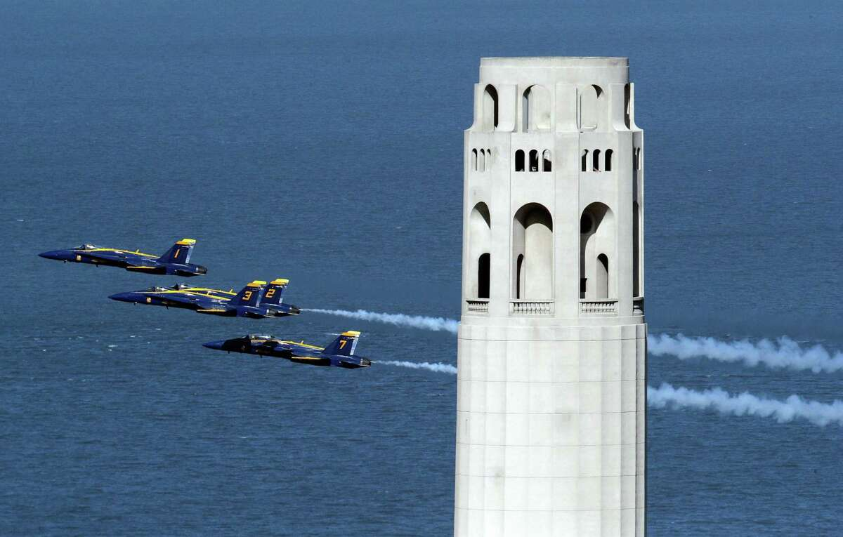 The Blue Angels practice their aerial maneuvers near Coit Tower over San Francisco Bay as seen from the Fairmont Hotel in San Francisco, Calif., on Thursday, October 10, 2019. The aerobatics team will be performing this weekend as part of Fleet Week.