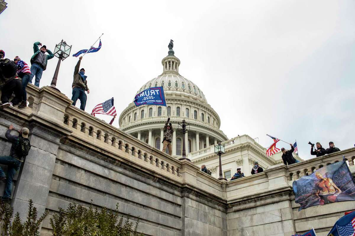 FILE -- Protesters on the Senate side of the United States Capitol in Washington on Jan. 6, 2021. (Jason Andrew/The New York Times)