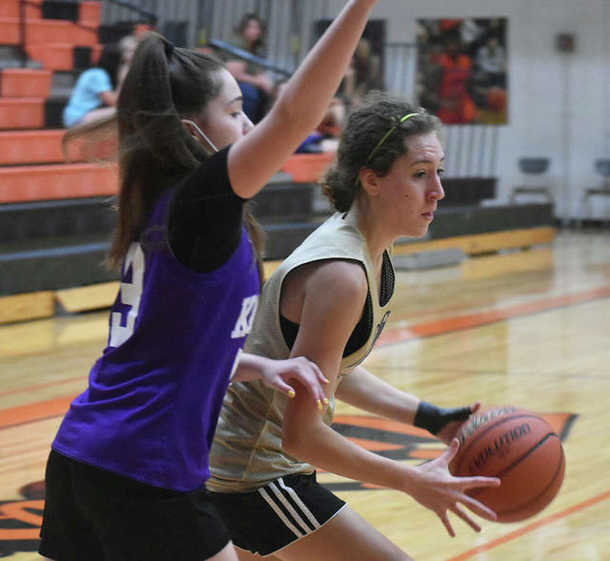 Father McGivney junior guard Emma Martinez drives to the basket during a summer scrimmage against Collinsville on Tuesday in Edwardsville.