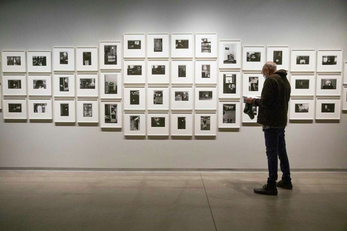 """Keith Silva views """"The Little Screens,"""" by Lee Friedlander, at Pier 24 Photography on Thursday in San Francisco. The reopening exhibition is """"Looking Back,"""" a retrospective on the private museum's first decade."""