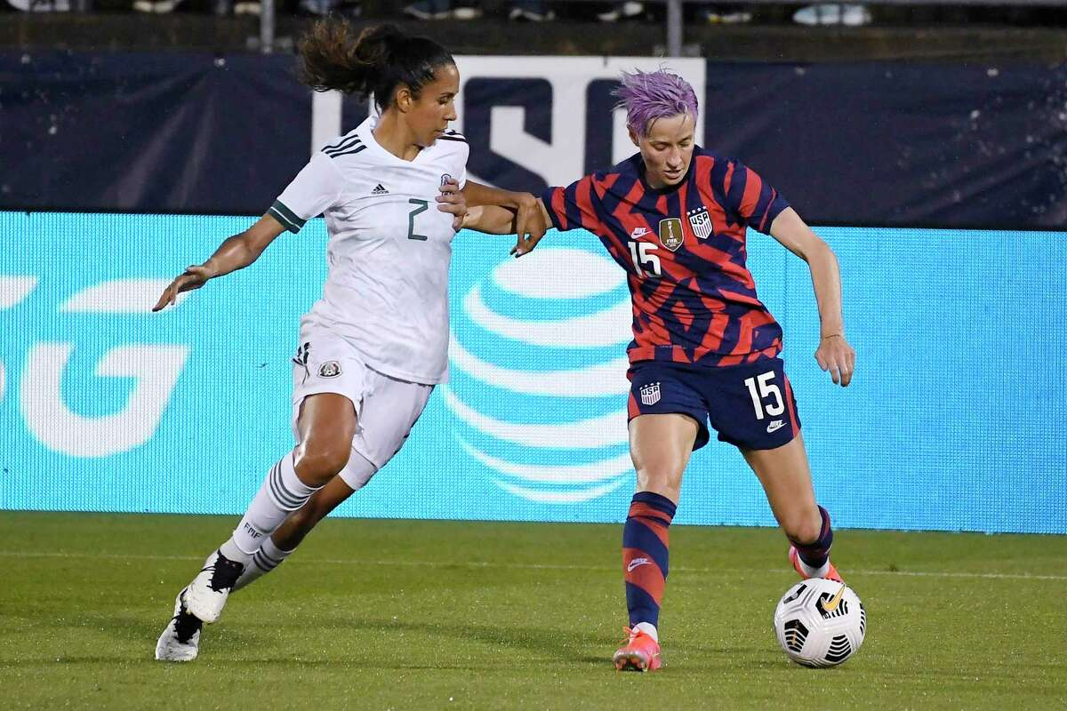 The United States' Megan Rapinoe controls the ball as Mexico's Bianca Sierra defends during an international friendly soccer match Thursday in East Hartford.