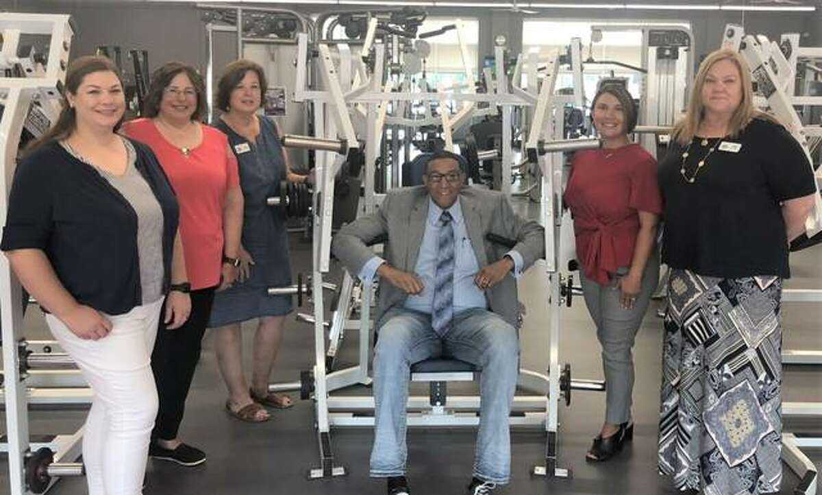 Alton Mayor David Goins, center, recently toured Senior Services Plus. He is pictured with, from left, Lora Giberson, Director of Finance; Shelli Brown, Director of Human Resources; Stacey Noble Loveland, Director of Operations; Theresa Collins, CEO; and Pam Jones, Director of Programs.