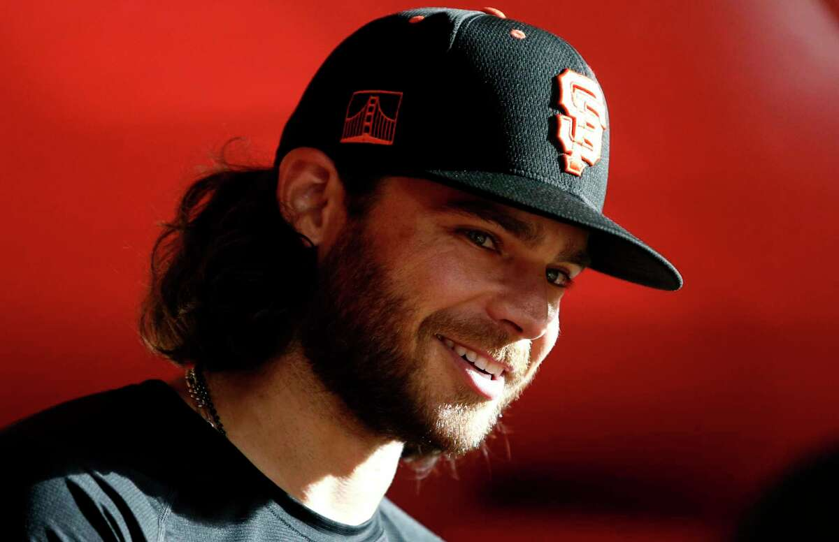 PHOENIX, ARIZONA - JULY 01: Brandon Crawford #35 of the San Francisco Giants talks with a teammate prior to the MLB game against the Arizona Diamondbacks at Chase Field on July 01, 2021 in Phoenix, Arizona. (Photo by Ralph Freso/Getty Images)