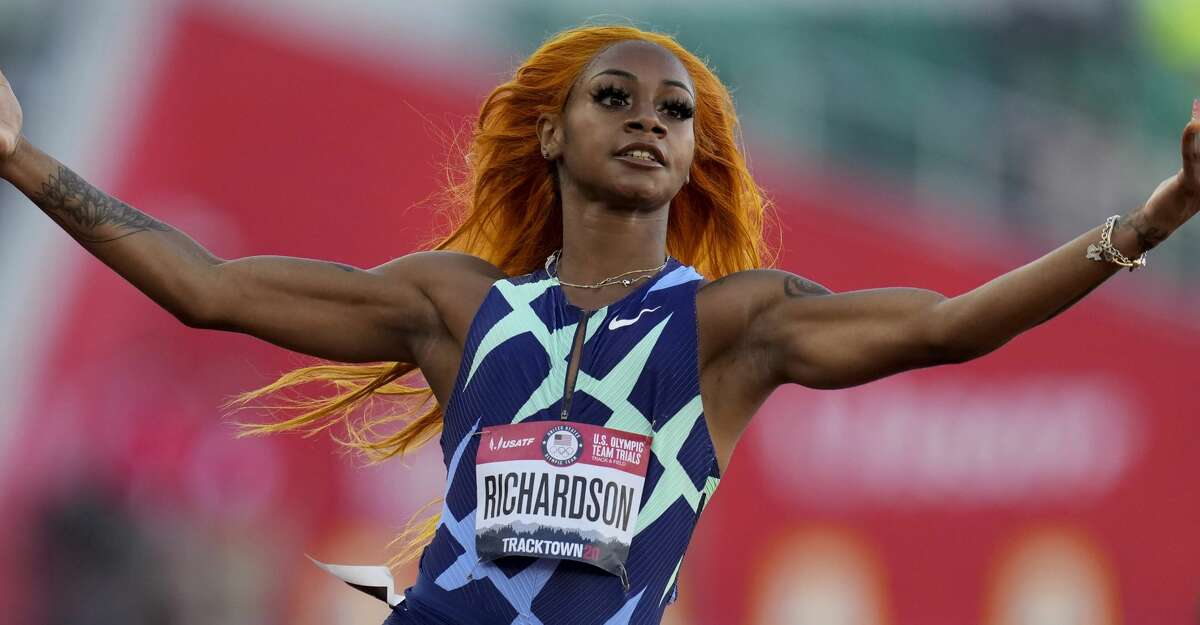 """Sha'Carri Richardson celebrates after winning the fourth heat during the women's 100-meter run at the U.S. Olympic Track and Field Trials Friday, June 18, 2021, in Eugene, Ore. Richardson cannot run in the Olympic 100-meter race after testing positive for a chemical found in marijuana. Richardson, who won the 100 at Olympic trials in 10.86 seconds on June 19, told of her ban Friday, July 2 on the """"Today Show."""" (AP Photo/Ashley Landis)"""