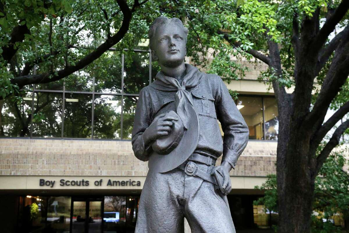 The Boy Scouts of America have reached an agreement with attorneys representing some 60,000 victims of child sex abuse in what could prove to be a pivotal moment in the organization's bankruptcy case. Attorneys for the BSA filed court papers late Thursday, July 1, 2021, outlining a restructuring support agreement with attorneys representing abuse victims. In this file photo, a statue stands outside the Boy Scouts of America headquarters in Irving, Texas.
