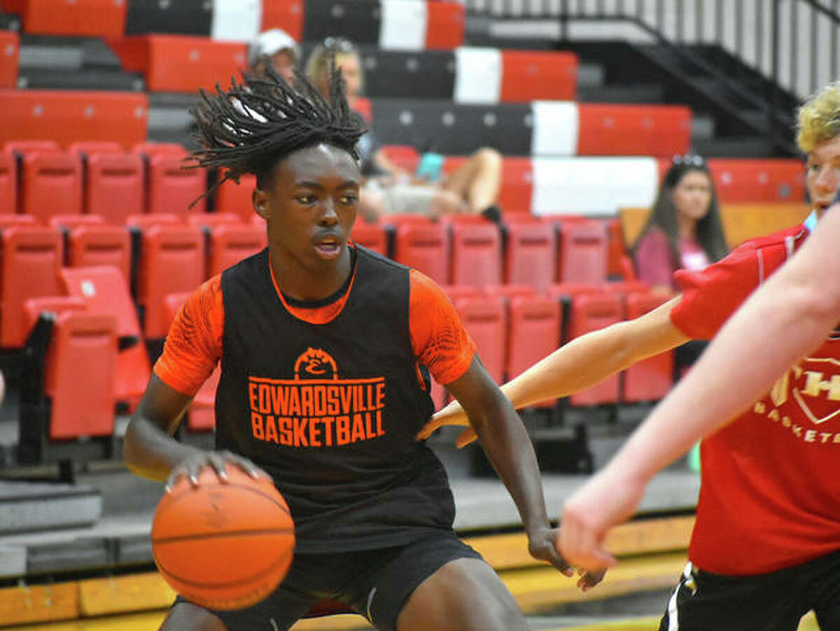 Edwardsville freshman Malik Allen drives to the basket during a scrimmage against Triad on Thursday in Troy.