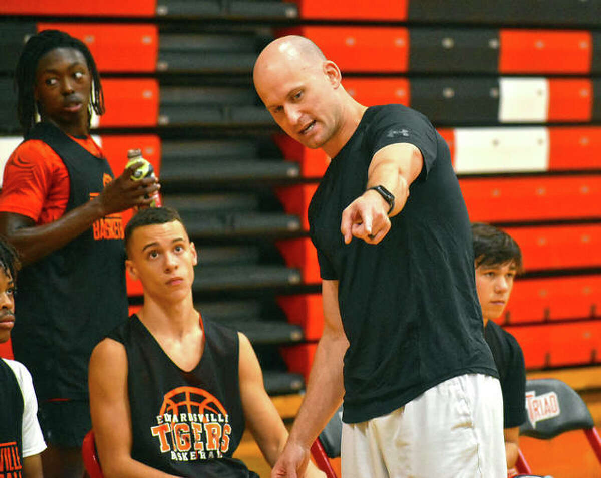 Edwardsville coach Dustin Battas talks to his team during a break in a scrimmage against Triad on Thursday in Troy.