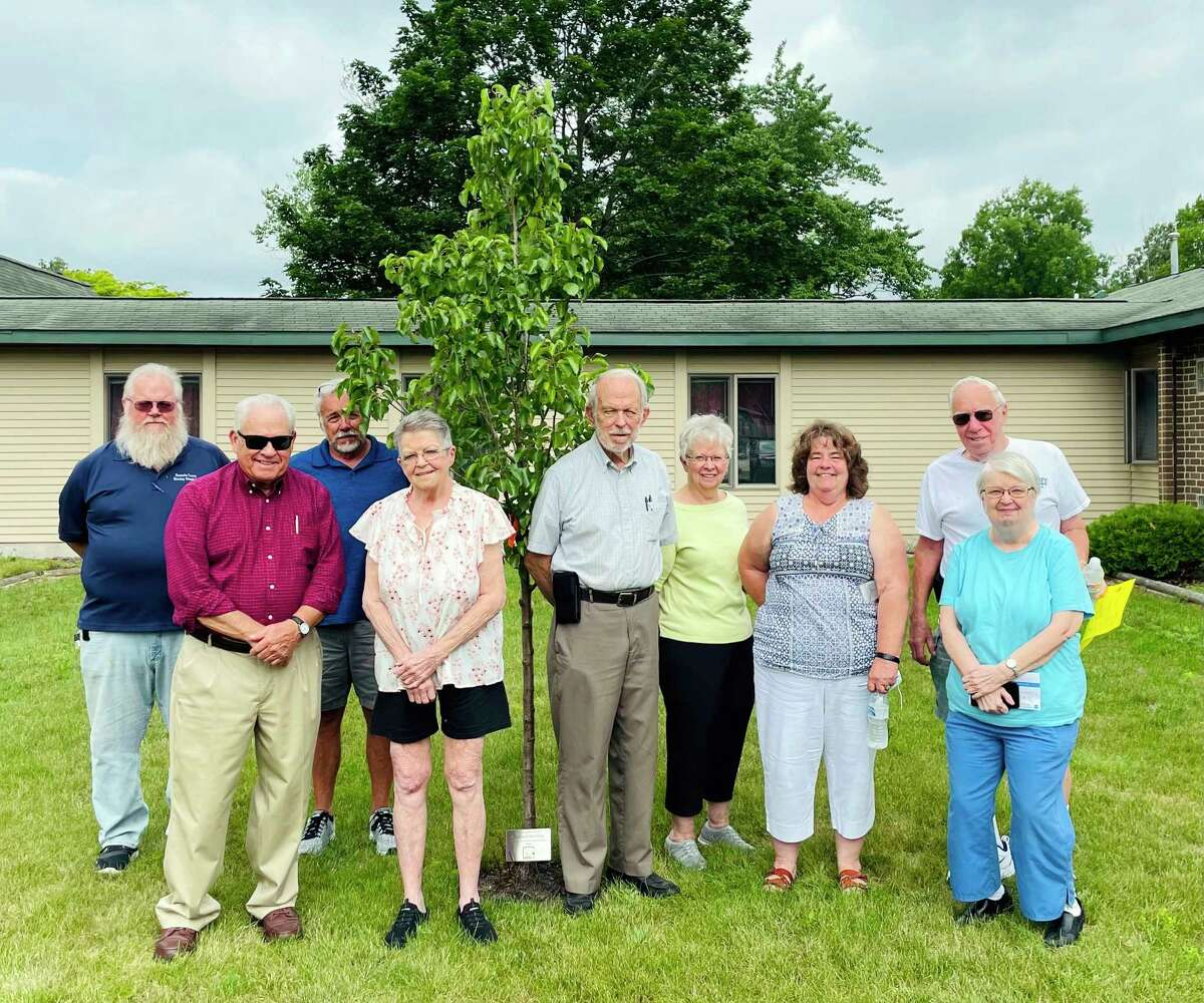 Members of the Montcalm County Housing Commission recently planted a Cleveland blossoming pear tree in honor of chairman and commissioner Richard Stevens. The tree was planted at Mulberry Estates.(Submitted photo)
