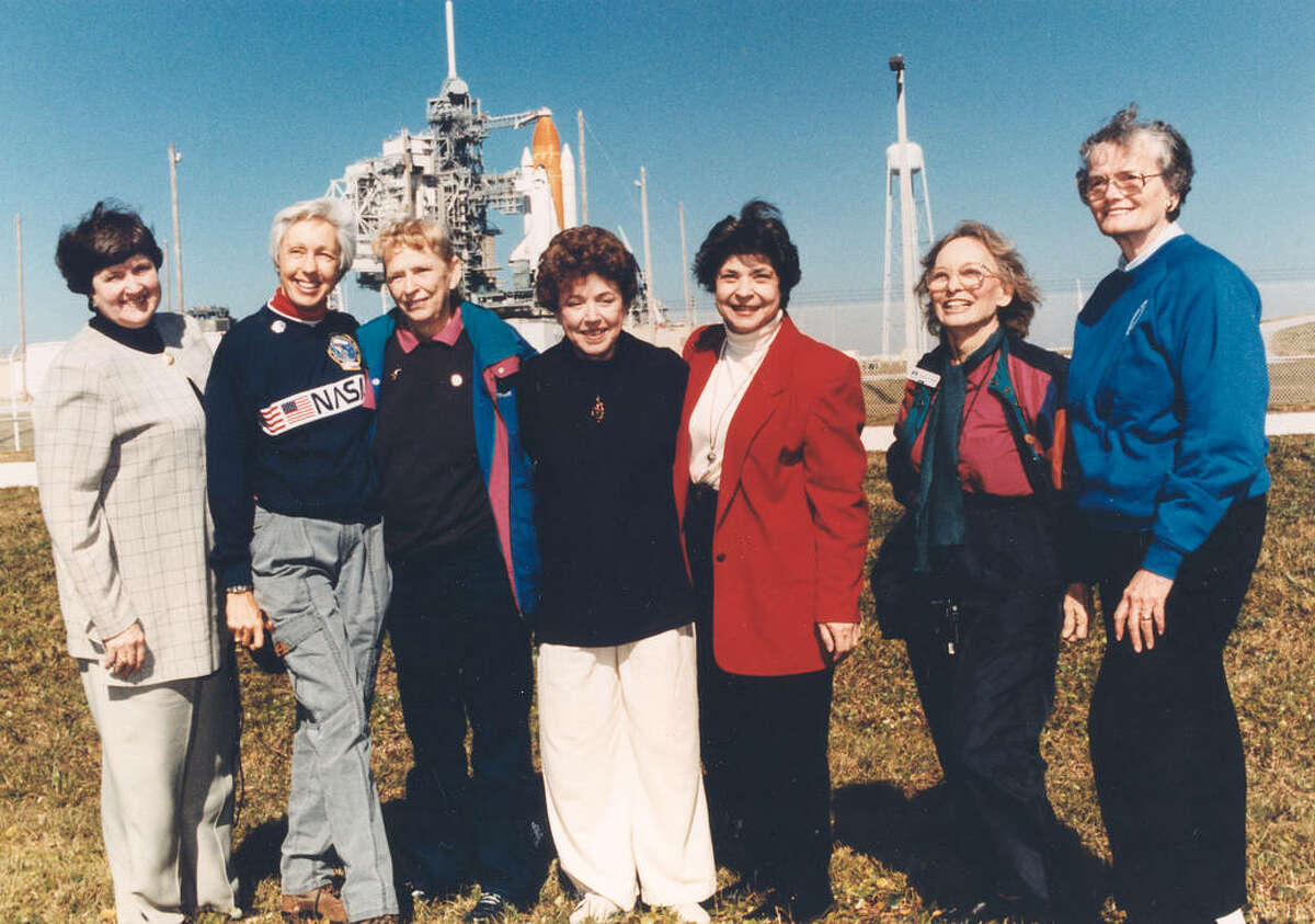 """Members of the First Lady Astronaut Trainees (FLATs, also known as the """"Mercury 13""""), these seven women who once aspired to fly into space stand outside Launch Pad 39B near the Space Shuttle Discovery in this photograph from 1995. The so-called Mercury 13 was a group of women who trained to become astronauts for America's first human spaceflight program in the early 1960s. Although FLATs was never an official NASA program, the commitment of these women paved the way for others who followed. Visiting the space center as invited guests of STS-63 Pilot Eileen Collins, the first female shuttle pilot and later the first female shuttle commander, are (from left): Gene Nora Jessen, Wally Funk, Jerrie Cobb, Jerri Truhill, Sarah Rutley, Myrtle Cagle and Bernice Steadman."""
