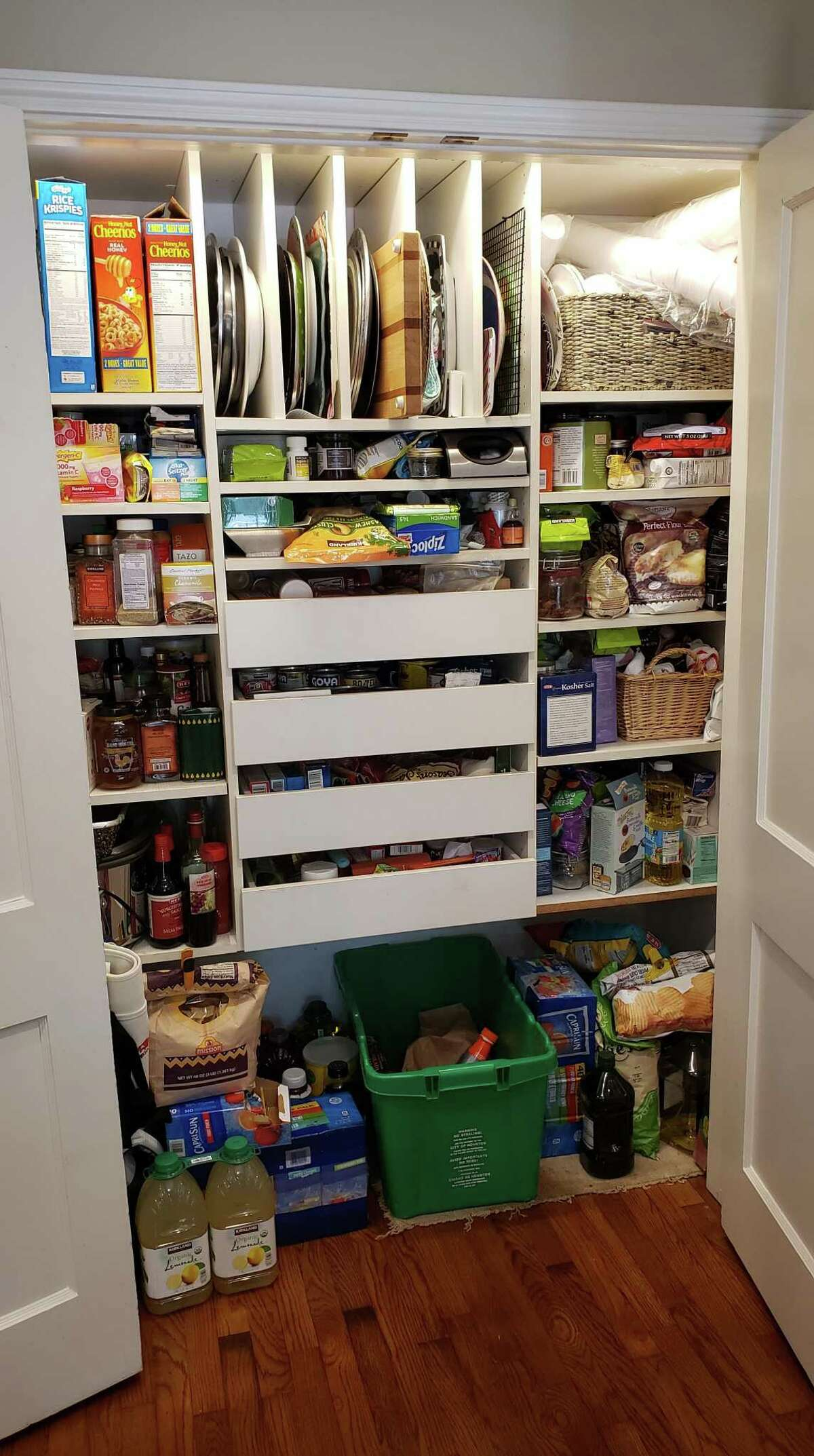 Before: The small pantry was always stuffed from shopping in bulk.