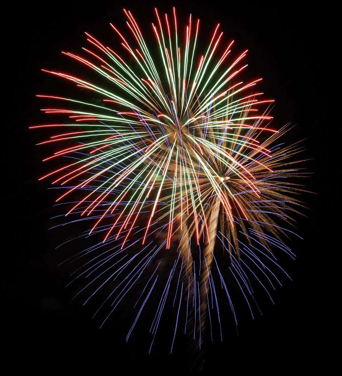 A multi-colored fireworks display explodes over Fairfield's shoreline in a star-spangled salute to the July 4 holiday.