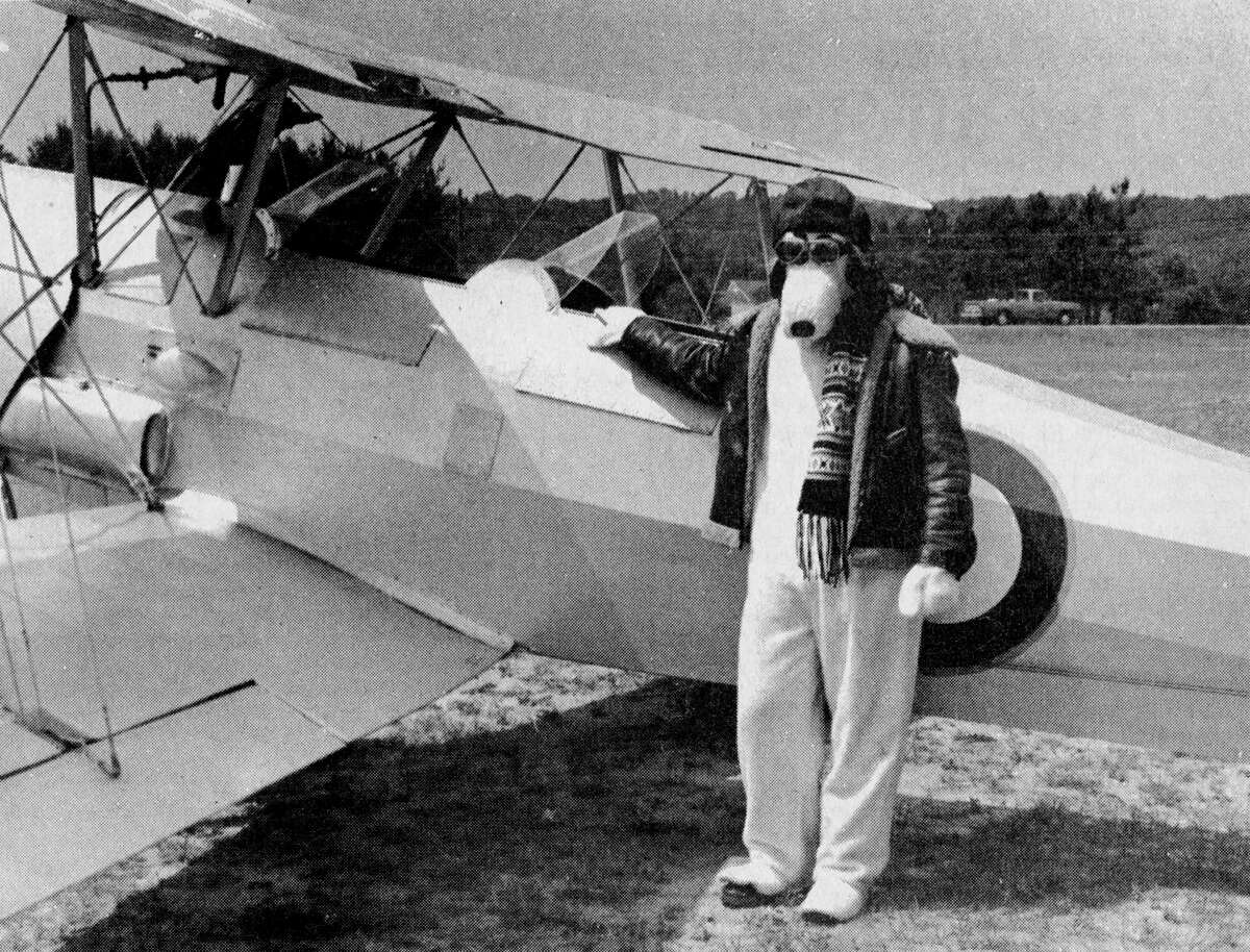 """The famed Red Baron hunter Snoopy, who flew into Manistee in his Sopwith Camel yesterday. Although Red Baron has never been sighted in these parts, the comical canine pilot of """"Peanuts"""" fame has decided to stick around for the Forest Festival's Fourth of July parade. The photo was published in the News Advocate on July 3, 1981. (Manistee County Historical Museum photo)"""