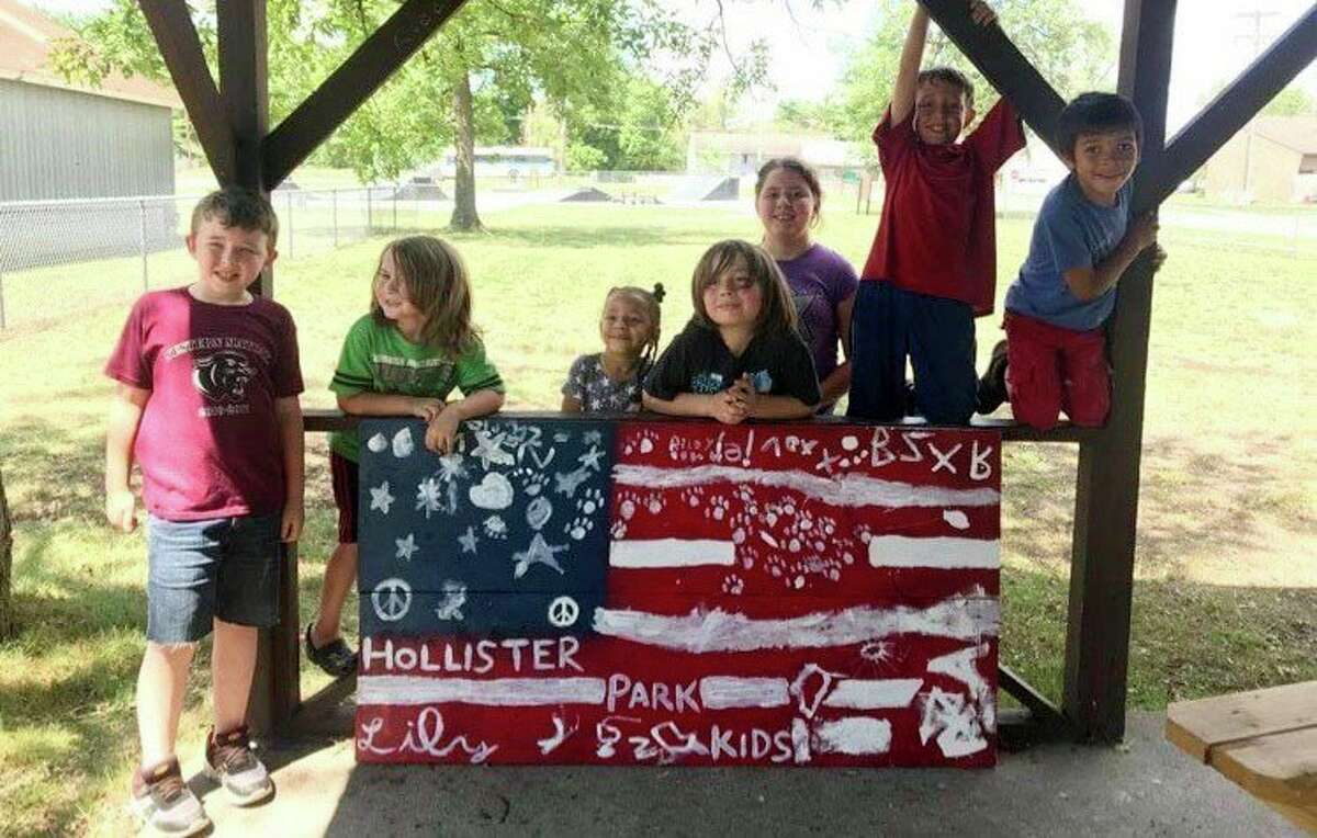 Pictured is the Kids Play Day activity held on June 30. Local kids created a patriotic flag, which is currently on display at Putkela Farms. (Submitted photo)