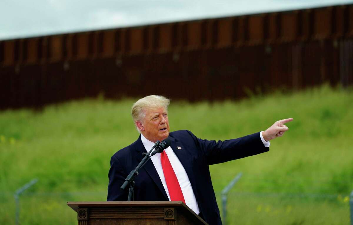 Former President Donald Trump speaks during a visit Wednesday to an unfinished section of border wall. A reader is unimpressed with Trump and Gov. Greg Abbott.