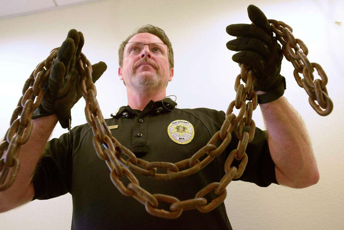 Shannon Sims, assistant director of Animal Care Services, holds a heavy chain removed from a medium-sized dog in San Antonio. For six years, Sims has taken these chains to the Texas Legislature to champion a bill that would criminalize restraining a dog. Gov. Greg Abbott let down Texans and dogs across the state with his veto of the Safe Outdoor Dogs Act.