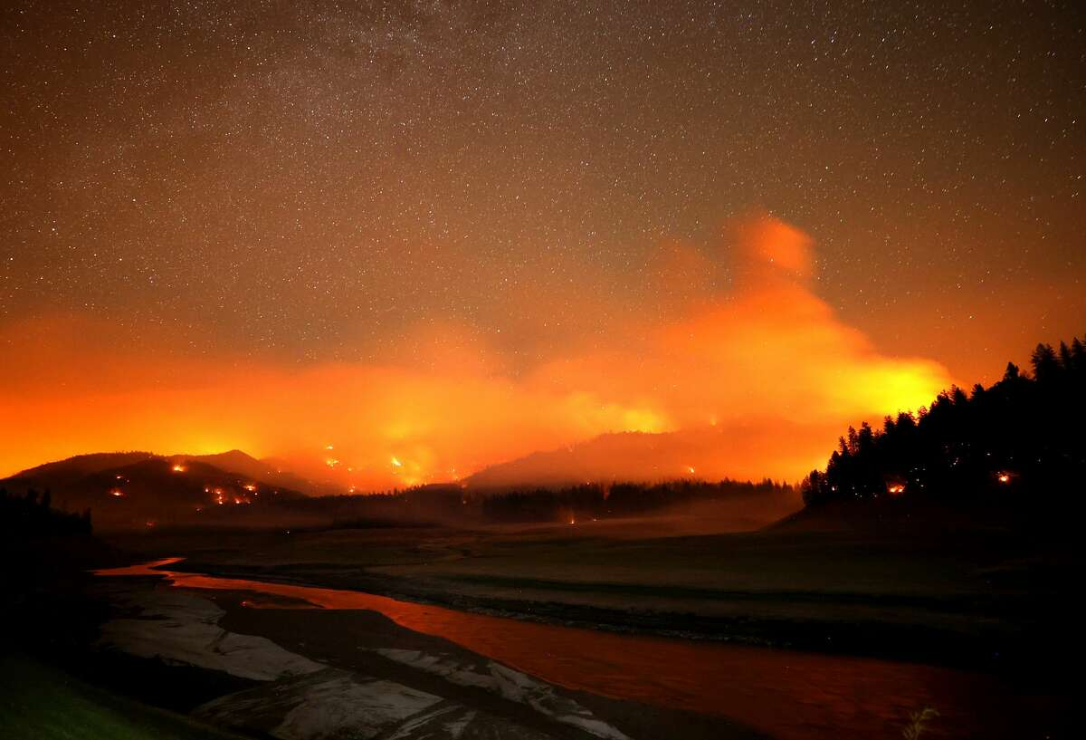 The Salt Fire burns in the hills above Shasta Lake on July 01, 2021 in Lakehead, California. The Salt Fire has burned over 4,600 acres in the past 24 hours and is currently zero percent contained.