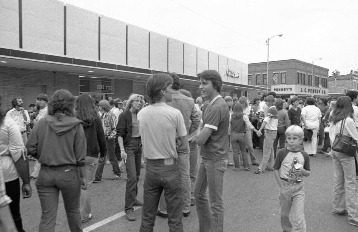 Crowds gather on River Street during theManistee National Forest Festival activities in early July 1981. (Manistee County Historical Museum photo)