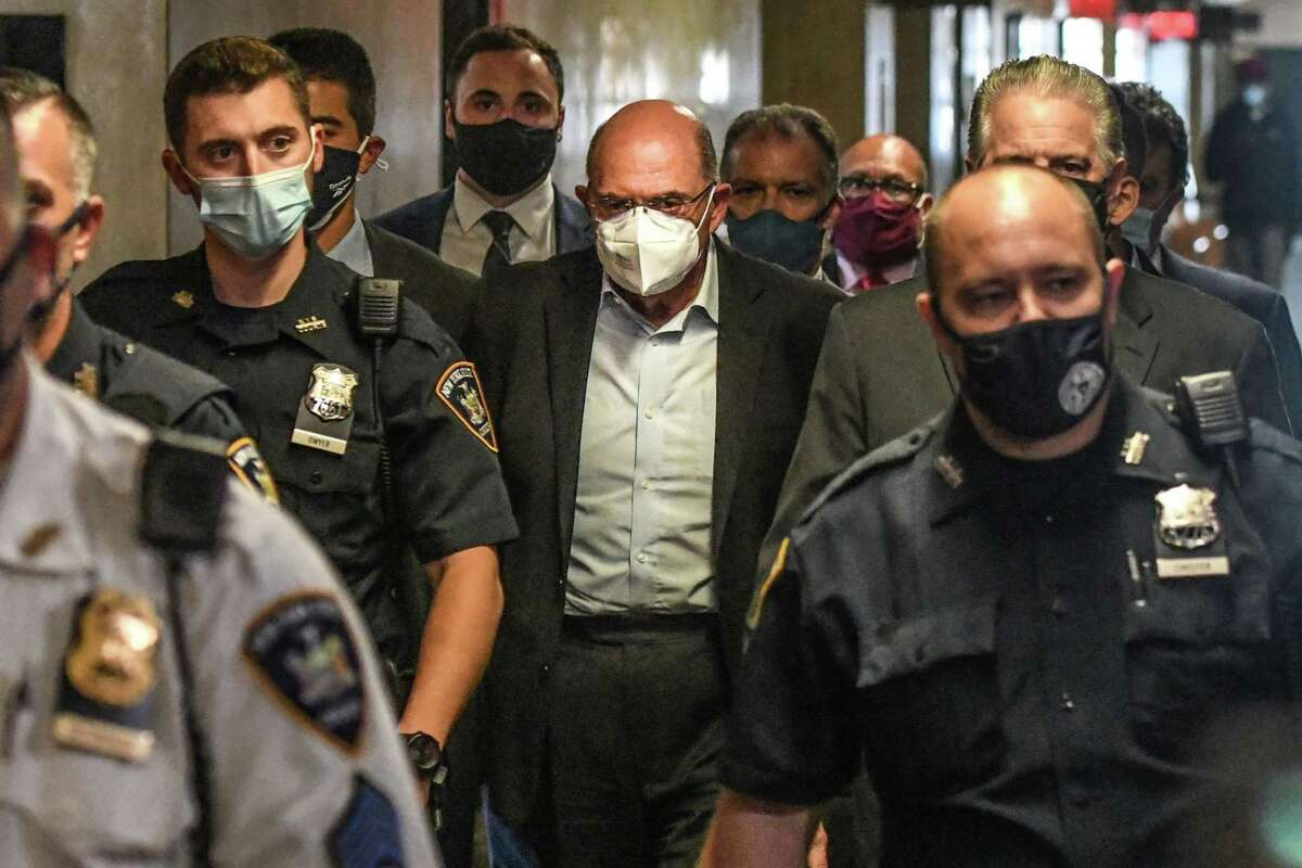 Allen Weisselberg, center, walks towards a courtroom at criminal court in New York, on July 1.