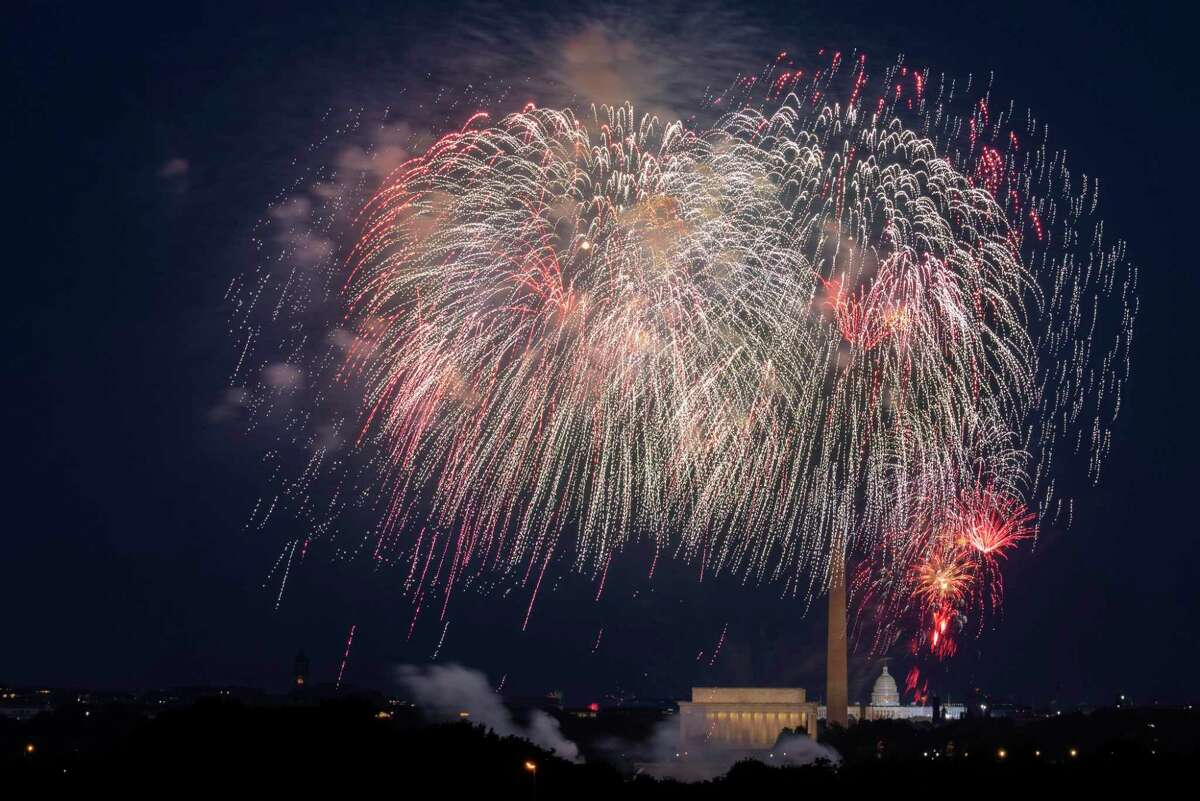 Fourth of July fireworks explode over the Lincoln Memorial, the Washington Monument and the U.S. Capitol in 2020.