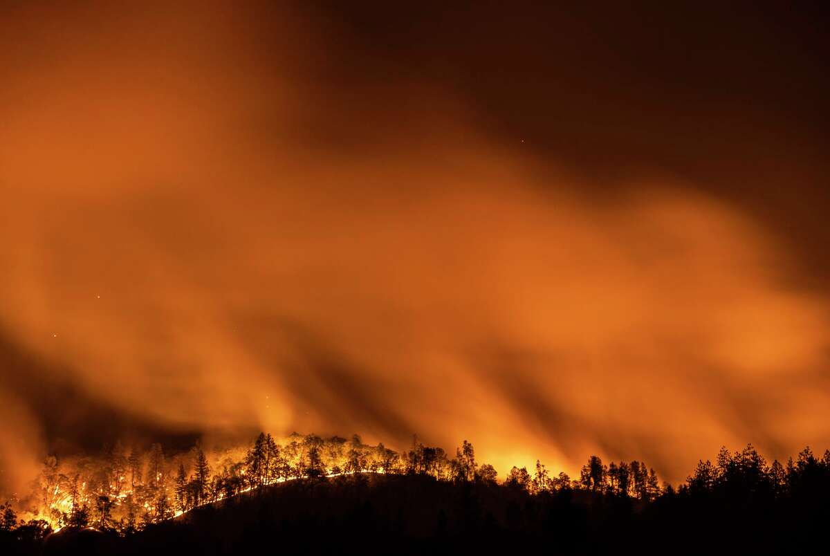 The Salt Fire is seen burning in the mountains in a long exposure photograph near Lakehead, Calif. The fire burned 4,500 acres and was 0% contained by Friday morning.