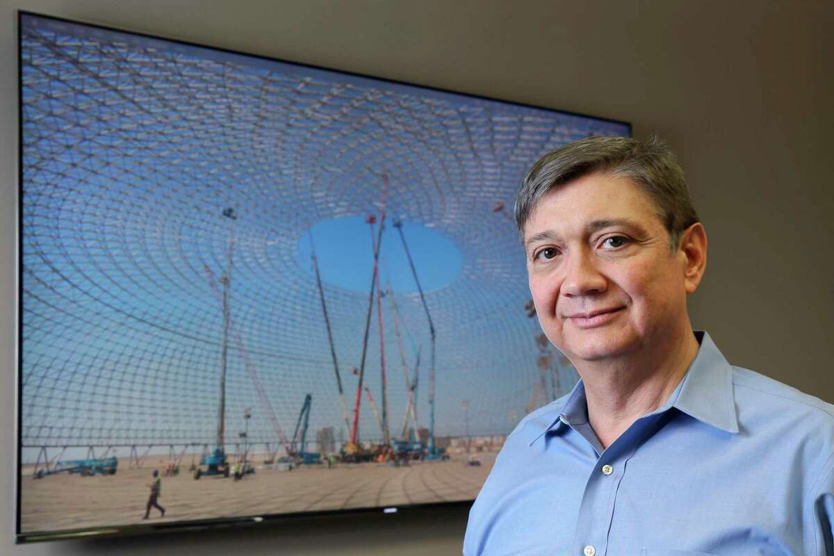 """Francisco """"Pancho"""" Castano, founder and CEO of Geometrica, by a wall monitor showing the Jeddah Superdome, a domed roof with a diameter of 689 feet, in his office Thursday, July 1, 2021 in Cypress, TX."""