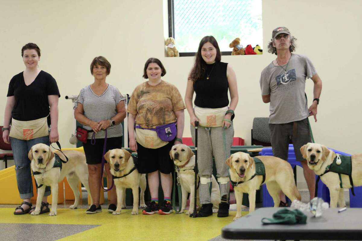 More than 60 ECAD supporters who attended the Team Training Graduation Ceremony in June to celebrate the four teams of client and service dogs receiving their certification diplomas. The event, held at ECAD's Training and Wellness Center in Winsted, was the first in-person graduation since the pandemic.