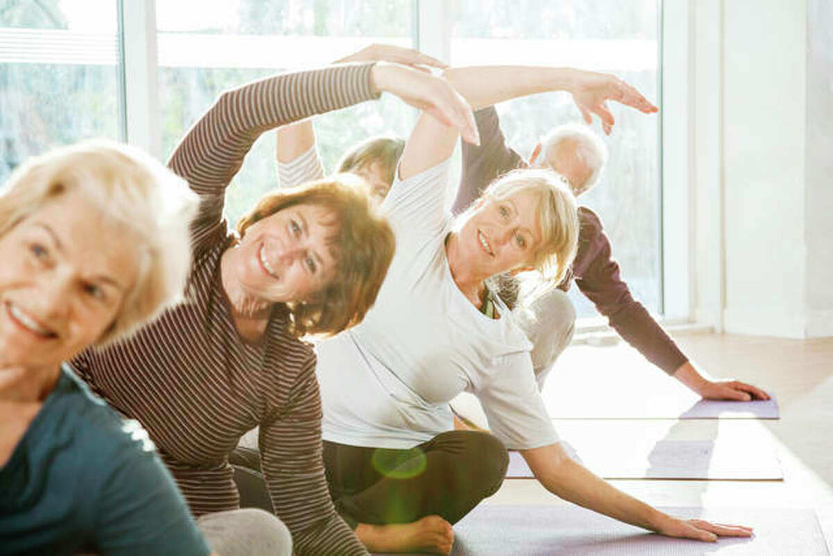 FILE - Elder citizens take part in a fitness class.