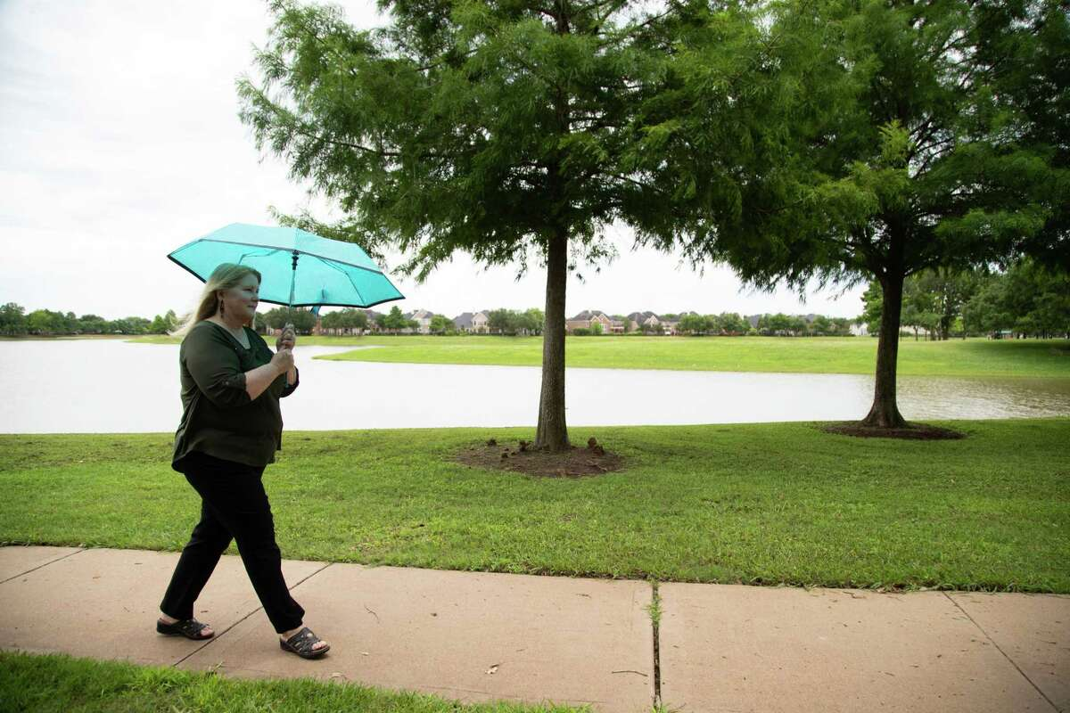 Yvette Ellerbe, 56, always carries several umbrellas in her car to make sure that if she has to be outdoor, she has an umbrella to protect her from the sun, Tuesday, June 1, 2021, in Richmond. Ellerbe been dealing with basal-cell carcinoma since age 39. She has learned to modify her habits, to go outdoors wearing long sleeves and put up an umbrella so she can stay in the shade.