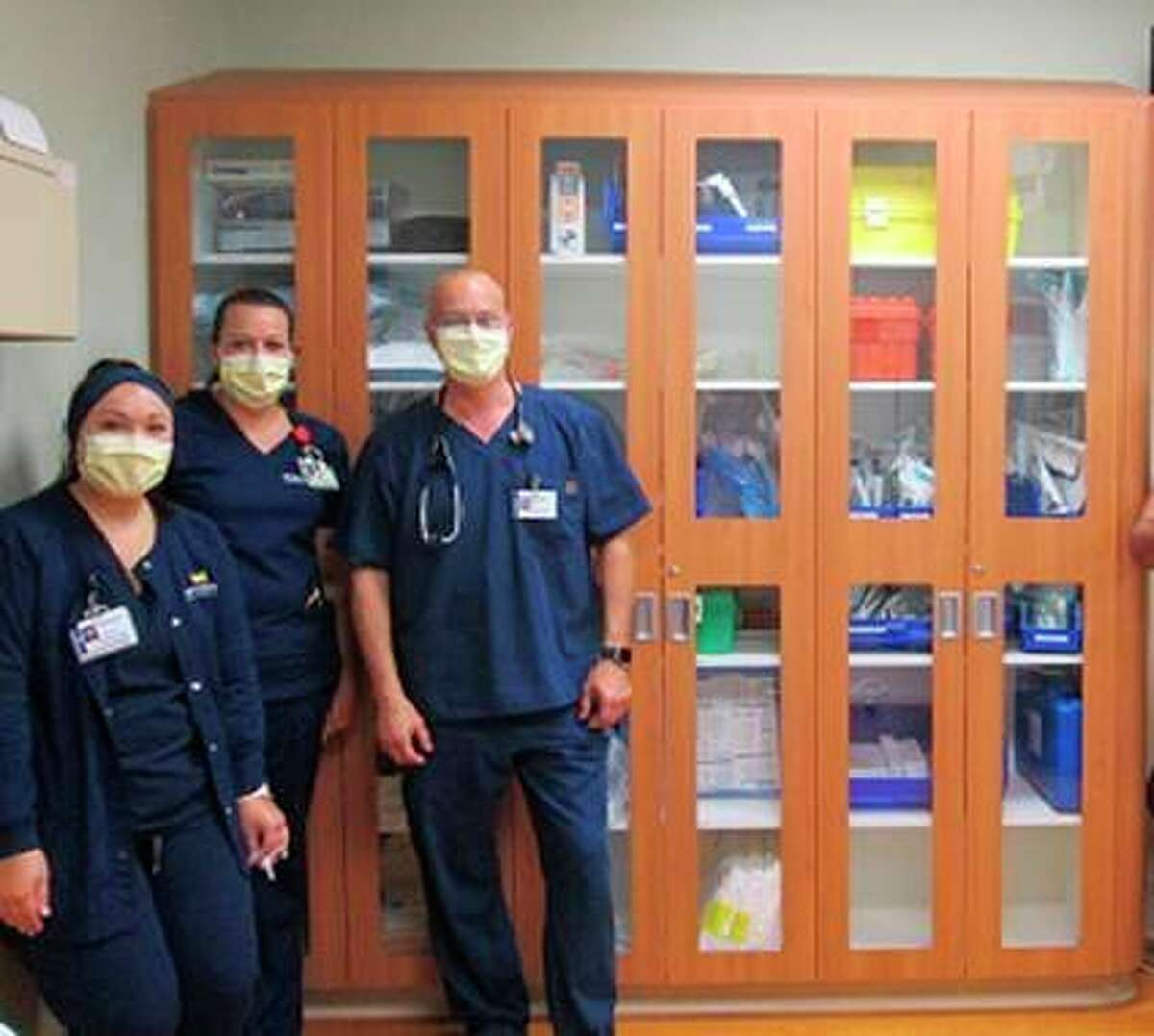 Emergency Room nurses gather with Dr. Merk in front of the new ER Trauma Room cabinetry. (Photo provided)